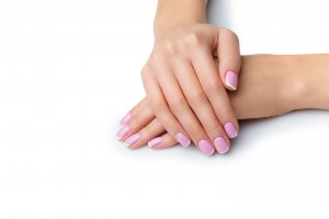Beautiful woman hands with french manicure. Isolated over white background. Copy space.